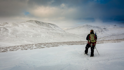 A hillwaker in the snow above Glenshee Scotland