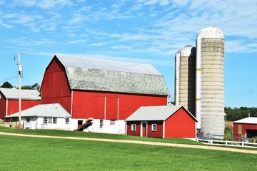 Red Barns with Silos