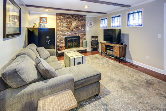 Basement living room space with fireplace