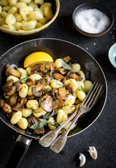 Prepared mushrooms and gnocchi dish in the pan,selective focus