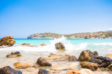 Powerful Waves on a rocky beach Voulisma, Agios Nikolaos, Istros. Greece Crete. Beautiful blue beach Travel, Tourism and Vacations Concept.