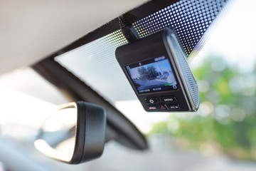 Video recorder next to a rear view mirror