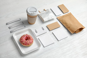 Composition with items for mock up design on wooden background. Food delivery service