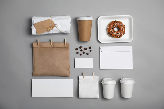 Flat lay composition with items for mock up design on gray background. Food delivery service