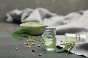 Bottles of hemp extract on grey table