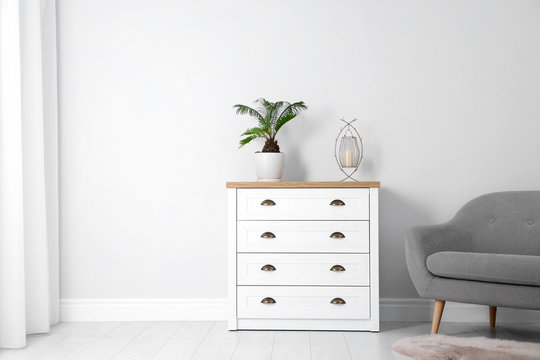 Chest of drawers in stylish living room interior
