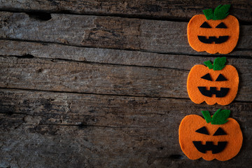 Top view of Halloween crafts, orange pumpkin on wooden background with copy space for text. halloween concept.