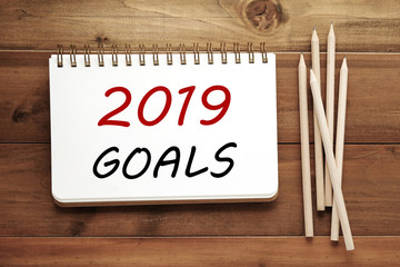 2019 goals on notebook paper background, banner sign, 2019 new year business strategy annual plan, success in business concept