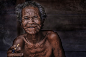 Smiling face of Old Asian man in countryside Thailand,