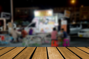 wood table top and Blurr night market