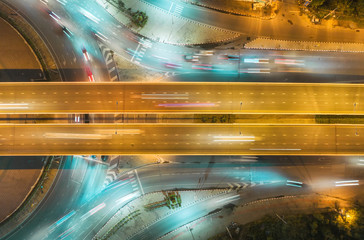 Fotobehang Nacht snelweg Aerial view highway road intersection at night for transportation, distribution or traffic background.