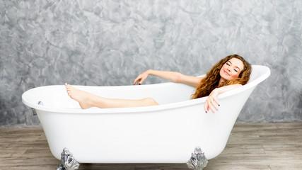 Young woman relaxing in bath.beautiful woman lying in bathtub.