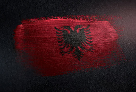Albania Flag Made of Metallic Brush Paint on Grunge Dark Wall