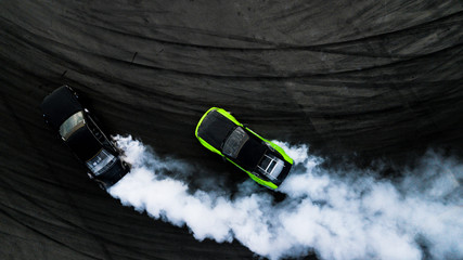 Aerial top view two cars drifting battle on race track, Two cars battle drift, Race cars view from above. Fototapete