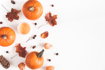 Autumn composition. Pumpkins, candles, dried leaves on white background. Autumn, fall, halloween...