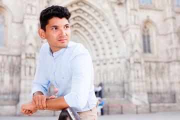 man posing in gothic quarter of Barcelona