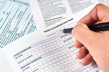 Human fills a prior authorization form