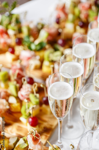 solemn happy new year banquet lot of glasses champagne or wine on the table in