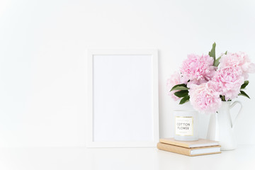 Elegant white blank frame mockup. Still life composition, summer bouquet of pink peonies in vase. Background, mock up for quote, promotion, lettering, lifestyle bloggers and social media