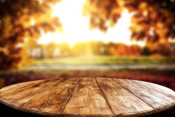 Table background and autumn landscape. Free space for your decoration.
