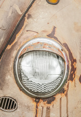 Wall Mural - headlamp and rusting vehicle hood close-up
