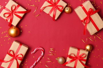 New Year's gifts, sweets and festive ribbons on a colored background. holiday, giving, new year, christmas, birthday