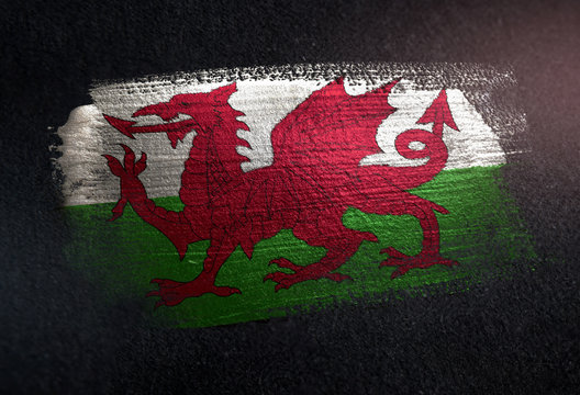 Wales Flag Made of Metallic Brush Paint on Grunge Dark Wall