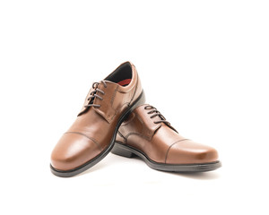 Studio shot top view brand new a shiny pair set of brown men dress cap toe Oxford dress shoes isolated on white background. Formal dress code for man