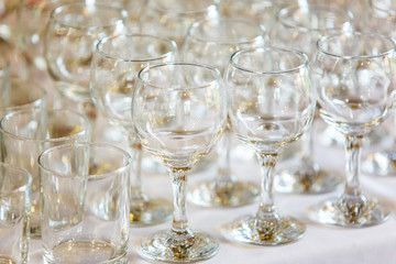 Empty wine glasses standing in row on table