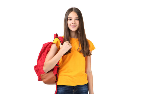 Young girl with backpack on white background