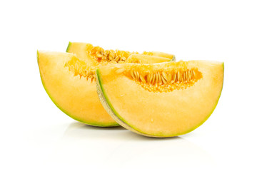 Group of three slices of fresh melon cantaloupe variety isolated on white background
