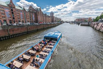Warehouse district of Hamburg (Speicherstadt). Cruise boats.