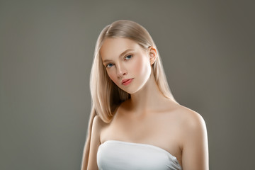 Beautiful Woman Face Portrait Beauty Skin Care Concept with long blonde hair  Wall mural