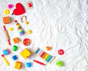 Kids bright colorful toys frame on white background. Top view. Flat lay. Copy space for text