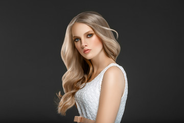 Beautiful Woman Face Portrait Beauty Skin Care Concept with long blonde hair