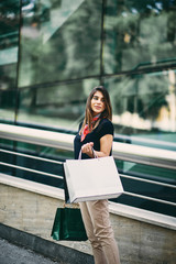 Portrait of woman going shopping in mall.