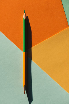 double-ended colored pencil on geometric  background