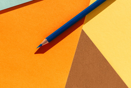 Blue pencil on geometric  background. Back to school