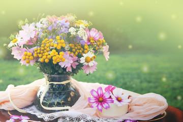 Wildflowers bouquet in a vase. Summer background.
