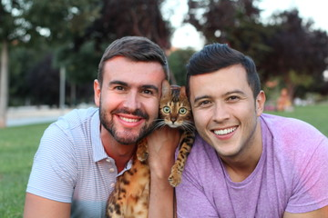 Healthy gay couple with a Bengal cat