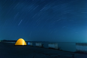 star trails and tent