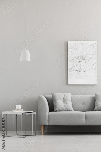 real photo of map poster hanging on the wall in living room interior with grey sofa - Hanging End Tables