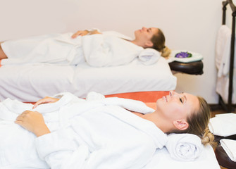 Two cute young women enjoying during a skin care treatment at a spa. massage and beauty treatments in the beauty salon
