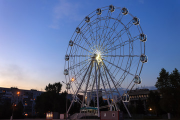 Ferris wheel in the evening in the park