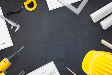 Construction industry concept. Projects and tools on work desk with free space for text. Hero header image concept. Flat lay, Top view.