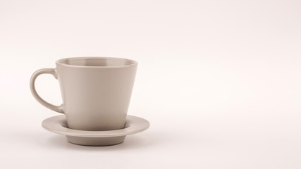 Small white coffee cup on white background