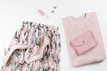 Woman clothes and accessories - skirt, sweater, pumps in pastel pink colors