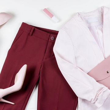 Woman work clothes and accessories - jacket, pants, pumps in pink and red colors