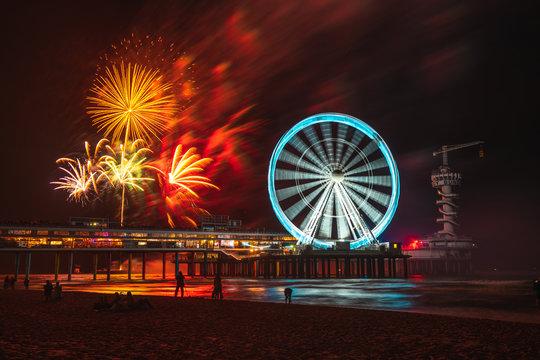 Scheveningen beach in the Netherlands and fireworkshow at night
