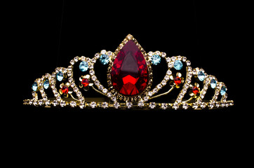 Wall Mural - gold diadem with red ruby stone isolated on black